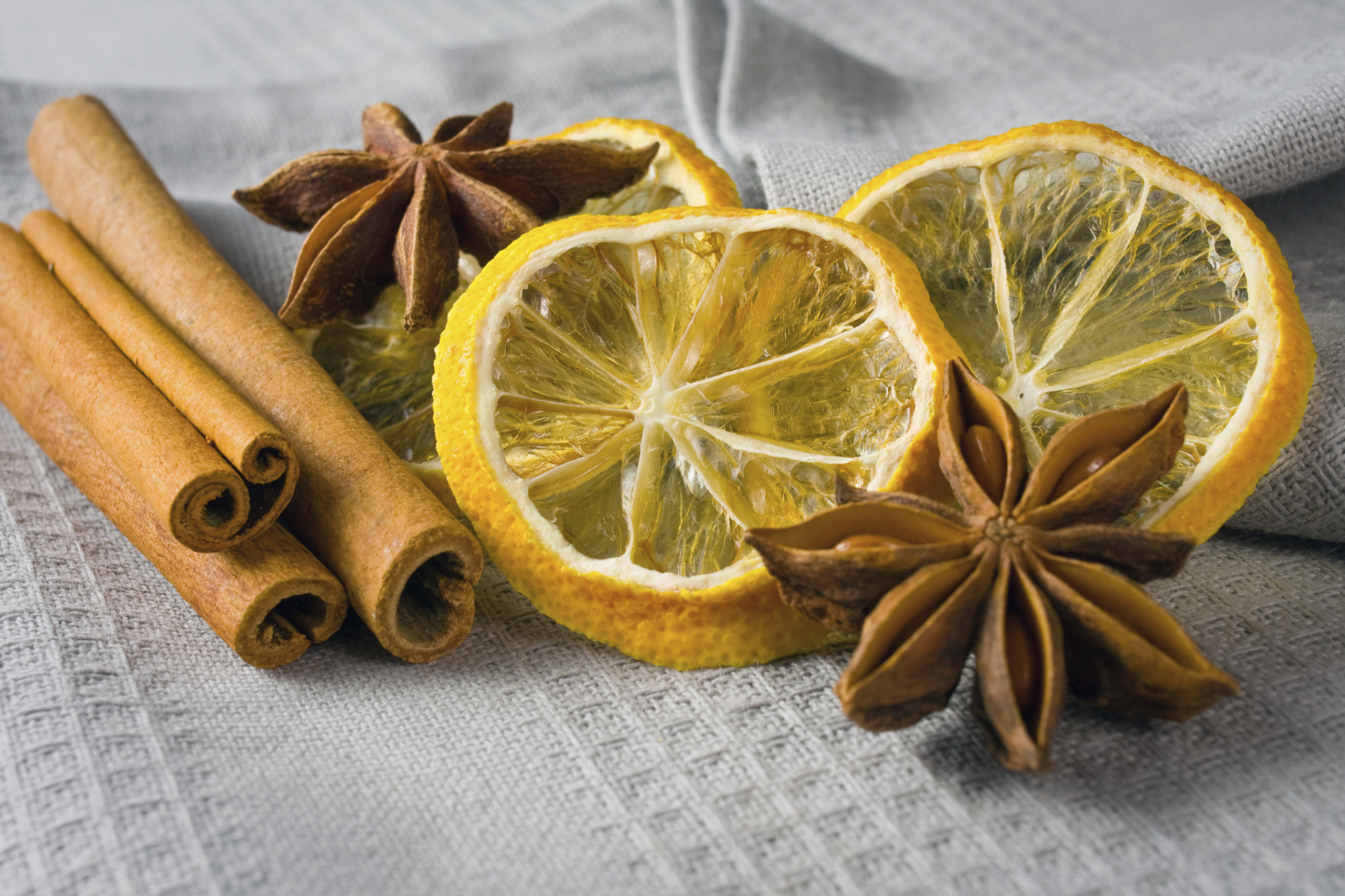 cinnamon sticks, anise stars and sliced of dried citrus
