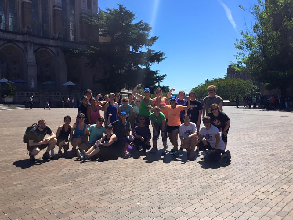Summer fitness challengers and the Whole U team posing after Chris Kirchoff's bootcamp on Red Square.