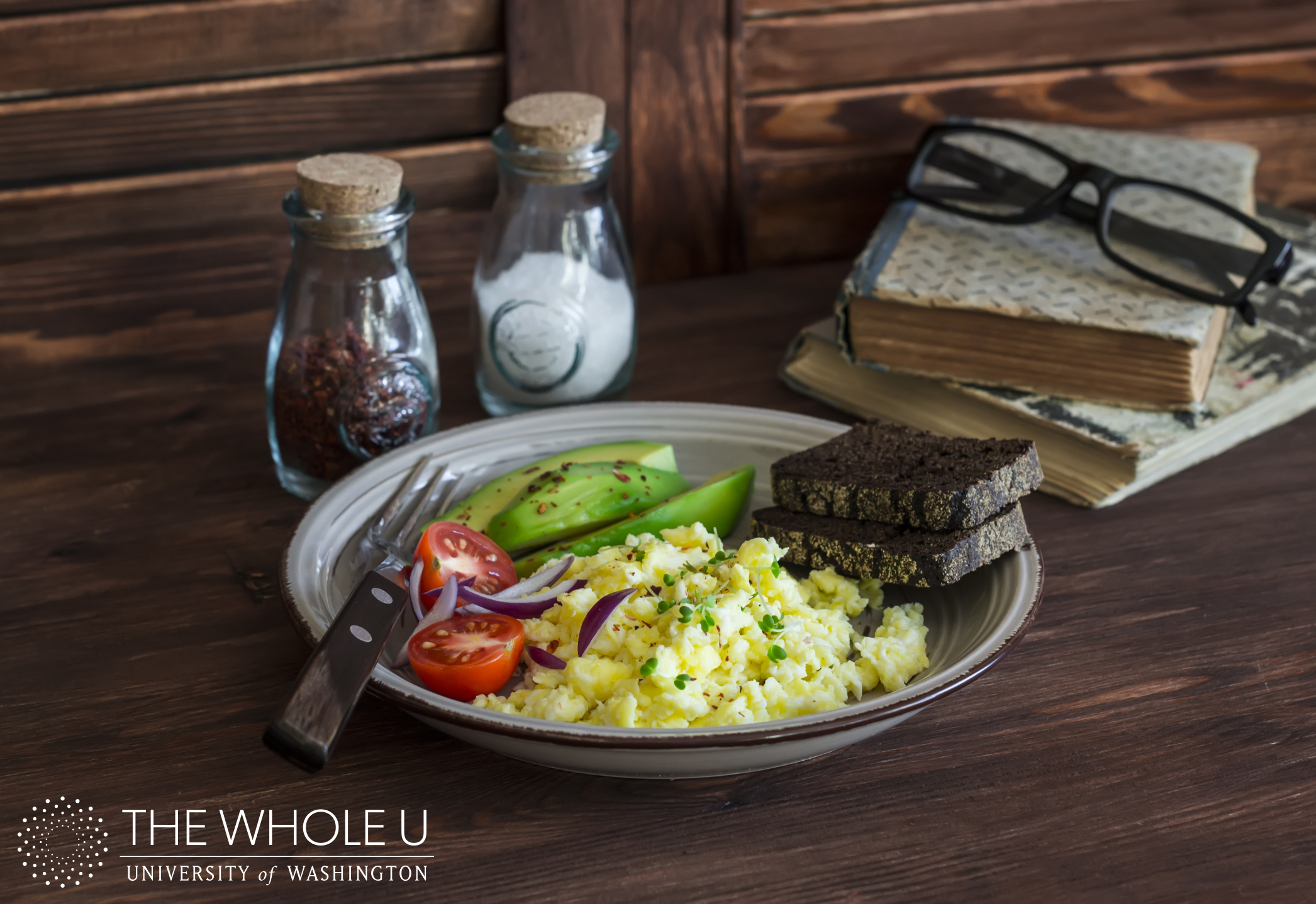 Healthy breakfast  - eggs scramble, avocado and cherry tomatoes