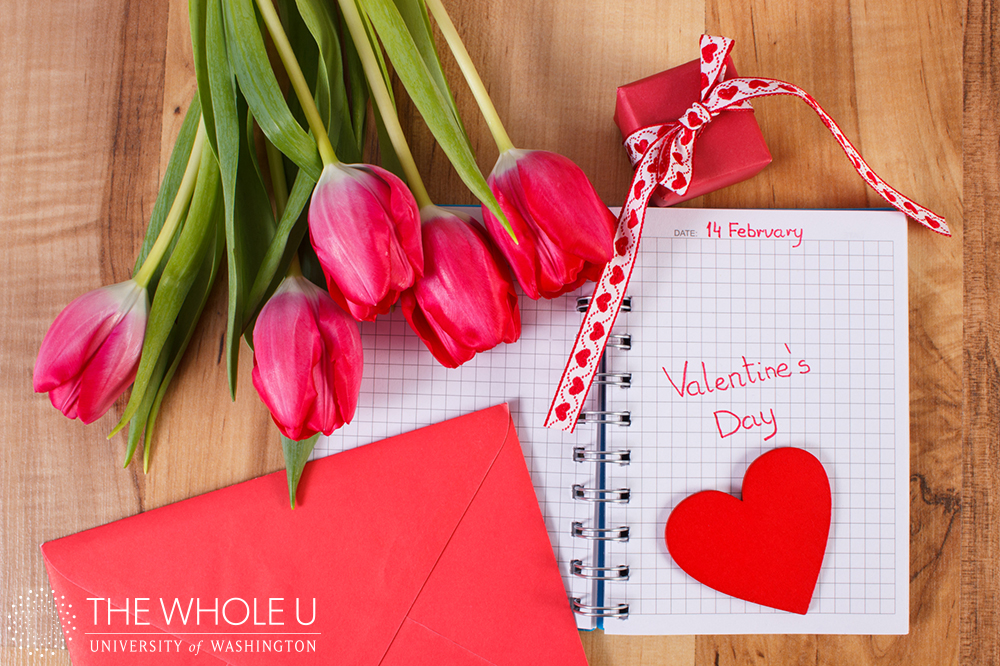 Valentines Day in notebook, tulips, love letter, gift and heart