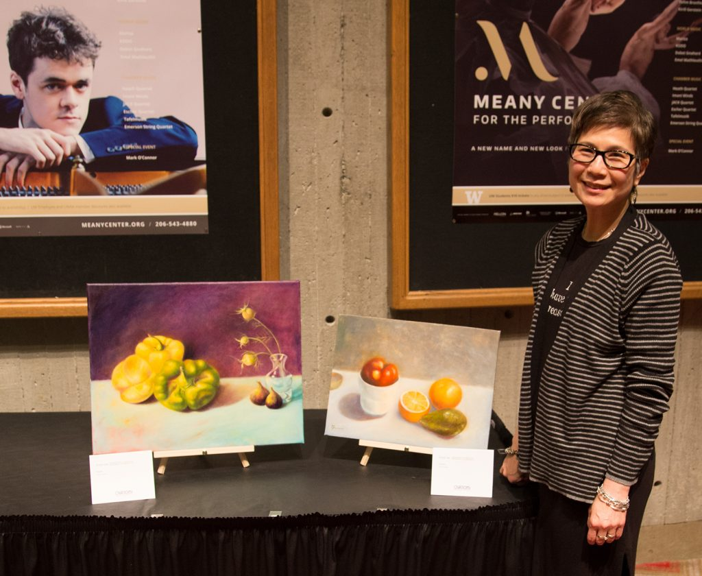 Here, Grace Lee stands with her luminous still lifes.