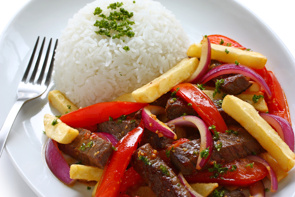 beef steak sauteed in olive oil with onions and tomatoes served over french fries and rice.